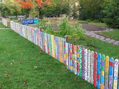 beautiful fence idea: Incorporates student art into the space.