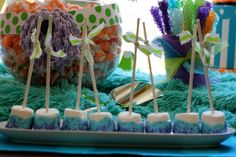 "monsters inc party ideas - marshmallow ""pops"" dipped in blue candy quik & purple sprinkles - sully .... easy & adorable!"