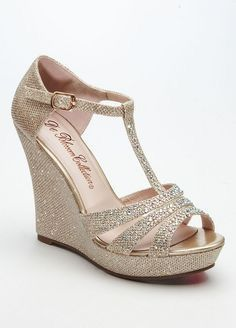 9df958f35449 Wedge T-strap sandal is embellished with glitter. Available in Champagne  and Silver.