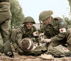 """According to the caption attached to this image, """"Canadian medics help a wounded soldier - Juno Beach, D-Day June Visuals such as this promote the idea that war doesn't only involve the 'killing' but the 'saving' as well. Canadian Soldiers, Canadian Army, British Army, British Tanks, Tiger Ii, World History, World War Ii, Combat Medic, Army Medic"""