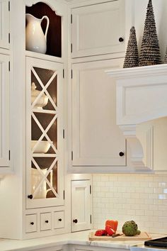 Clever Kitchen Storage Ideas For The New Unkitchen - laurel home | beautiful kitchen storage | design by Heidi Piron | love the white on white!