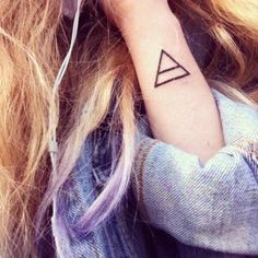 It's an alchemy symbol for air. It stands for creativity, intelligence, new beginnings as air is something that's not permanent and always changes.. Also, means explore as a glyph if I am not mistaken. Triangle Tattoo