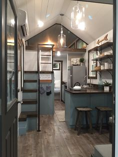 Sweet Grass – Tiny House Swoon....I love that the stairs to the lofted bed has a railing. I think that's my favorite part.