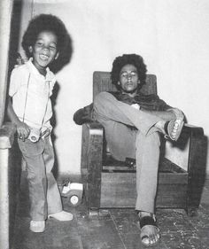 "Ziggy & Bob Marley - -Although Bob didn't let any ""any grass grow under his feet"" you can still see the difference he made in his son's life by this one picture. I don't know how effective he was on the ones who came after the first four, but better than nothing. Ziggy's persona is so calm cool and laid back. I think he was stricter with the Melody-makers than Bob was with the I-threes !"