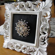 What a cool way to display a bright bit of bling–framed jewelry (from Hodge:Podge)