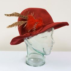 Red doeskin felt hat with feather detail. - 100% Wool - Wired brim for shaping