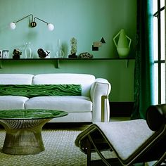 Shades of malachite and jade put a  twist on a 1930s palette in this modern living room scheme