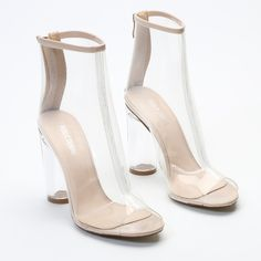 Be the star of the show in these bad boys! Spotlights on you with the perspex heel glimmering. These booties have serious attitude with a completely see through upper and the peeptoe keeps your toes free to wiggle. Pair these with a culotte style jumpsuit in hues of khaki, green and navy. We're throwing over our floaty duster coats that ooze Kimmy K style.   Heel Height: 4.2\