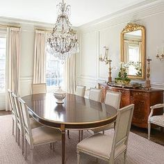 Oval French Dining Table with Gold Trim and Gray Linen Square Back Dining Chairs