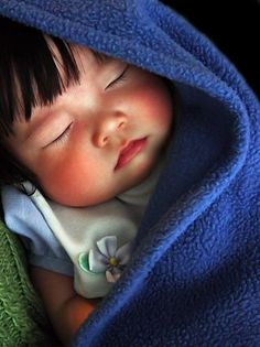 baby in a blue blanket