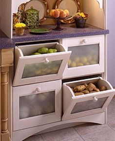 Here's a great idea for the kitchen, tilt-out bins to store fruits and vegetables.