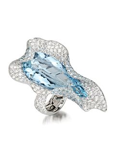 PALMIERO RING |   A white gold shell-shaped ring, set with pale blue topaz, white and coloured diamonds.