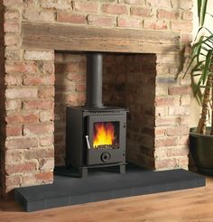 Looks like the wood stove version of my home hearth. Would this work in NH? Log Burner Fireplace, Fireplace Hearth, Home Fireplace, Wood Burner, Fireplace Surrounds, Fireplace Design, Wood Mantle, Fireplace Ideas, Brick Chimney Breast