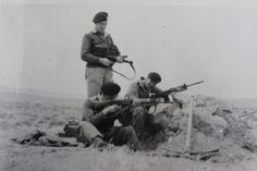 3rd Battalion Grenadier Guards Drum Major, Tom Cornall; L/Cpl. Banks and Drummer Tyrrell in a sangor during a Battallion Defence exercise. Libya 1959