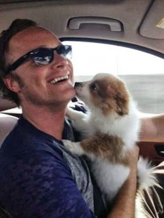 A cute picture of David Anders and puppy.
