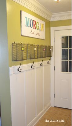 Awesome entryway command center with wire baskets and hooks above the board and batten | 100+ Beautiful Mudrooms and Entryways at Remodelaholic.com