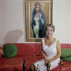 Joan Crawford with her Academy Award, handy Pepsi-Cola, Keane portrait and plastic slipcovers!