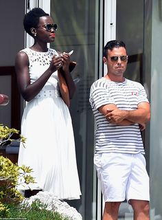 Soaking up the rays: Lupita Nyong'o chilled out on the balcony of her hotel on the second ...