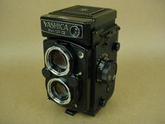 i love my yashica 44- but i think i am going to purchase the yashica MAT-124 because it takes 120 film