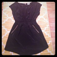 Useful black dress!! Dress up or down  This dress can be worn on a night out with heels, casual lunch with flats or wedges or to work with pumps... super versatile. Has a slight sheen but not too much. Elastic waist, zipper in the back. I have worn once. Offers accepted  Dresses