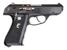 """A Hecker & Koch Model P9S factory cutaway pistol, serial number Sch 2 (for """"Schnitt Modell 2"""", or Cutaway 2). The grip, frame, slide and barrel have been cut away to show the internal workings, with all of the opened areas outlined in red. The magazine has also had its sides milled away to reveal its interior. The P9S is one of the most simple pistol designs, with a roller-locking breech block and a parabolic rifled bore."""