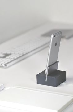 DOCK sits elegantly on your desk, nightstand providing a sleek and stable base for charging your iPhone or iPad.