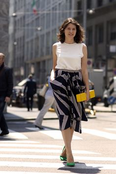milan style from the sartorialist.blogspot.com.....can't go wrong with a pop of yellow and fn shoes!