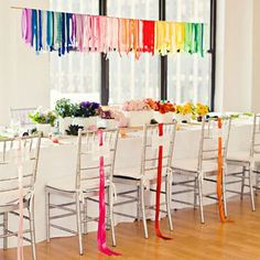 Brides: Rainbow Flower and Ribbon Tablescape. Another great example of a stylish (and restrained) rainbow tablescape: Silver chairs paired with white linens and vases keep the overall effect streamlined—and make the colors really pop. Rainbow Wedding Decorations, Party Decoration, Rainbow Centerpiece, Hanging Centerpiece, Hanging Decorations, School Decorations, Table Decorations, Rainbow Parties, Rainbow Theme