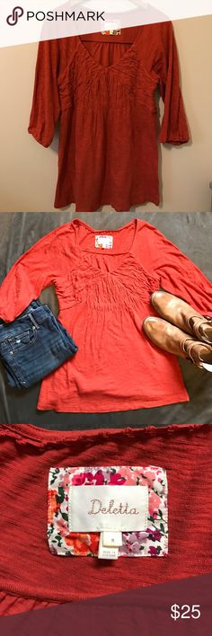 Burnt orange ANTHROPOLOGIE TOP 💜😻💜 Burnt orange ANTHROPOLOGIE TOP  made by Deletta💜😻💜 in EUC in a size medium. The picture where it is hanging up gives a more accurate realistic color. It's a beautiful burnt orange color that is perfect with brown boots! Anthropologie Tops