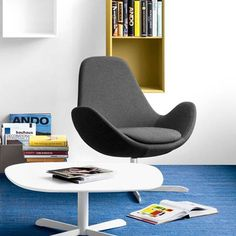 Electa is a comfortable swivel armchair, with clean and round lines, designed for relaxing while keeping everything within reach. It features a high backrest and wide seat for maximum comfort.