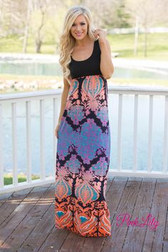 Everyone loves a good maxi and this one just happens to be a Pink Lily favorite! The black bodice is simple and classic, while the skirt is a bold damask pattern in shades of orange, teal, white, and purple.