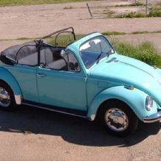 Pale turquoise VW Beetle convertible. Everything about this is my favorite.