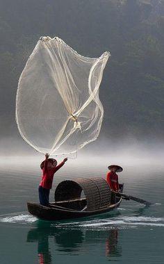 Pêcheurs à Chenzhou, Hunan, Chine