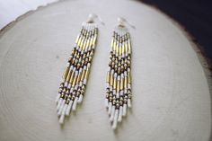 ◇ Gorgeous native made fringe earrings using high quality glass czech seed beads, bugle beads and sterling silver ball hook ear wires ◇ MEASUREMENTS ↠ Length: 4 and 5/8th of an inch (5 with the ear wire) ↠ Width: 6/8th of an inch at widest point ◇ MATERIALS ↠ Size 2 czech glass bugle