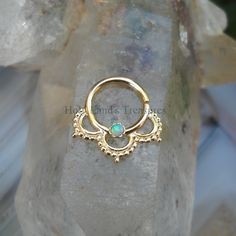 Tribal Septum Ring - Septum Piercing - Septum Jewelry - Septum Nose Ring -  14K Solid Yellow Gold Septum Ring Set With a 2mm Blue Opal by Holylandstreasures on Etsy https://www.etsy.com/ca/listing/269560849/tribal-septum-ring-septum-piercing