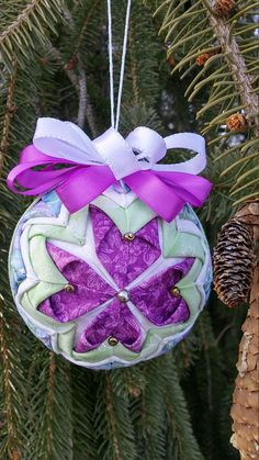 This beautiful ornament was made to brighten up anyone's home for Easter or Spring. The colors just say spring is here. If you are looking to brighten up your space then this might do the trick. It would make a good gift for a little girl, a teacher or even a great Mothers Day