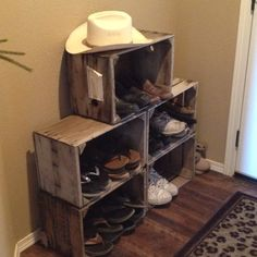 Grape crates as a shoe rack! Love the rustic look of it & lots of room for our big shoe collection ;)