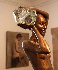 Every day this Bronze Lady holds a new ice block in a small room surrounded by paintings. On entering all you hear is the constant, slow dripping of the melting ice