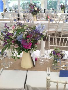 Purple mixed with blues and pinks in this pretty jug of wedding flowers ...