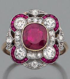 An Art Deco platinum, 18k gold, Burmese ruby and diamond ring.