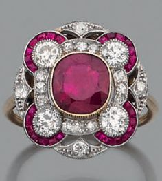 An Art Deco platinum, 18k gold, Burmese ruby and diamond ring.
