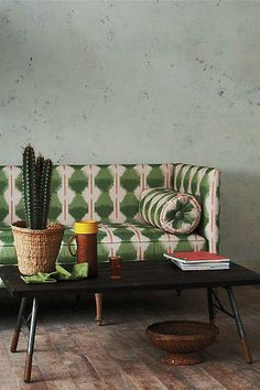 the cactus and the pattern on the sofa are a perfect match for a home in the south