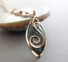 Swirly marquise copper pendant necklace with wrapped by IngoDesign, $37.00
