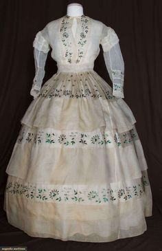 White organdy skirt and blouse decorated with silver embroidery and iridescent beetle wings, c. 1860s (blouse remade in the 1930s).