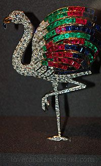 "the exotic ""Flamingo Clip Brooch,"" made up of diamonds, rubies, sapphires, emeralds, citrine and platinum. The Duke of Windsor provided Cartier with four bracelets and had the brooch made as a special order for the Duchess of Windsor in 1940"