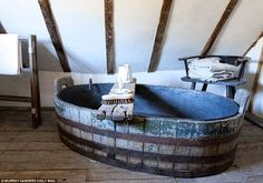 The attic floor in Alastair Hendy's Tudor home has had to be reinforced so it can withstand the weight of the lead-lined bath once it is full of water