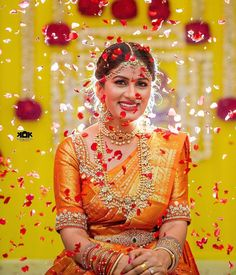 Looking for Bridal portrait idea for south indian bride with petal shower? Browse of latest bridal photos, lehenga & jewelry designs, decor ideas, etc. on WedMeGood Gallery. Indian Wedding Poses, Indian Bridal Photos, Indian Wedding Photography Poses, Bride Photography, Photography Ideas, Marriage Poses, Wedding Photoshoot, Wedding Shoot, Wedding Bride