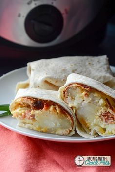 Simple hot breakfast that cooks while you sleep! Check out this Crockpot Breakfast Burritos Recipe! #SimplyPotatoes
