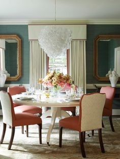White dining table and fabulous chandelier    Lindsey Coral Harper