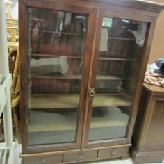 Antique Bookcase / Cabinet --  Glass front doors and three small drawers below the doors --- 60 tall x 46 x 15 1/2 --- $1600.00